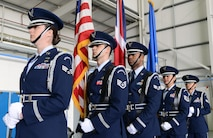 The 352nd Special Operations Wing Honor Guard detail prepares to post The Colors prior to the official redesignation of the 352nd SOW and the activation of the 752nd Special Operations Group and 352nd Special Operations Maintenance Group in Hangar 814 on RAF Mildenhall, March 23, 2015. (U.S. Air Force photo by Tech. Sgt. Stacia Zachary/Released)