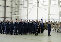 The 352nd Special Operations Maintenance Group formation stands at parade rest while U.S. Air Force Col. Eric V. Faison, 352nd SOMXG commander, gives remarks following the activation of the new maintenance group March 23, 2015, in Hangar 814 on RAF Mildenhall, England. (U.S Air Force photo by Tech. Sgt. Stacia Zachary/Released)