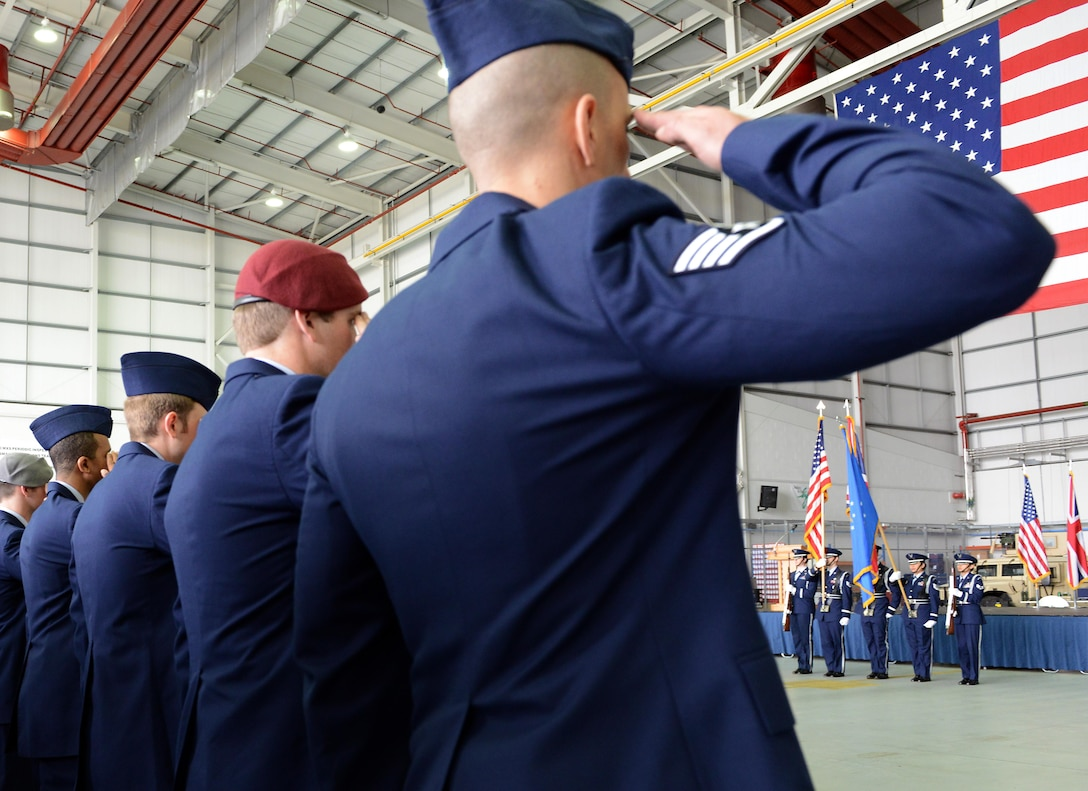 Air Commandos from the 752nd Special Operations Group render a salute as the U.S. and British national anthems are played just prior to the offical redesignation of the 352nd Special Operations Group to the 352nd Special Operations Wing March 23, 2015, in Hangar 814 on RAF Mildenhall, England. Immediately following the anthems, the 352nd Special Operations Group was redesignated as the 352nd Special Operations Wing. The 752nd Special Operations Group and the 352nd Special Operations Maintenance Group were activated. (U.S Air Force photo by Tech. Sgt. Stacia Zachary/Released)