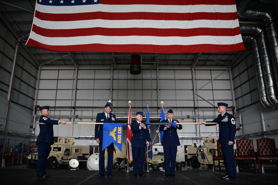 U.S. Air Force Lt. Gen. Brad A. Heithold, second from left, Air Force Special Operations Command commander, U.S. Air Force Col. William Holt, center, 352nd Special Operations Wing commander, and U.S. Air Force Lt. Col. Nathan Green, second from right, 752nd Special Operations Group commander, perform the 352nd SOW activation ceremony, March 23, 2015, on RAF Mildenhall, England. The 352nd SOW is responsible for planning and executing specialized and contingency operations using advanced aircraft, tactics and air refueling techniques to infiltrate, exfiltrate and resupply special operations forces.  (U.S. Air Force photo by Senior Airman Christine Griffiths)
