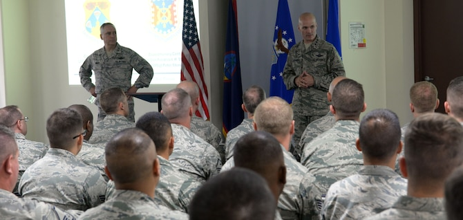Lt. Gen. Carlton D. Everhart II, 18th Air Force commander, and Maj. Gen. Frederick Martin, U.S. Air Force Expeditionary Center commander, speak with Airmen from the 734th Air Mobility Squadron March 23, 2015, at Andersen Air Force Base, Guam. Everhart and Martin responded to several questions from Airmen during the 734th AMS all call. (U.S. Air Force photo by Airman 1st Class Joshua Smoot/Released)