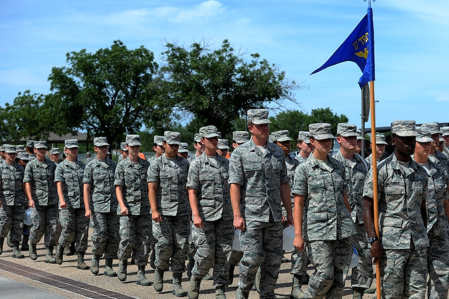 GOODFELLOW AIR FORCE BASE, Texas -- 17th Training Group students march from class on the troop walk July 1, 2014. 17th TRG leadership will change the rules for pipeline students just entering the military in order to make more effective use of their time and focus more on character development April 1, 2015. (U.S. Air Force photo/ Airman 1st Class Devin Boyer)