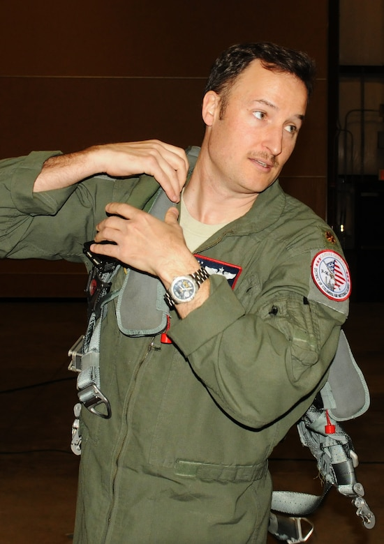Pilot Maj. Wyck Furcron, with the 121st Fighter Squadron, sprints to the F-16 Fighting Falcon aircraft, quickly donning his flight equipment in response to a real-world red alarm scramble March 14. The 113th Wing's Aerospace Control Alert Detachment reached a milestone of responding to 5,000 alert events on March 21. The alert unit was created in response to the 9/11 terrorist attacks on the United States on Sept. 11, 2001. (Air National Guard photo by Master Sgt. Becky Vanshur)