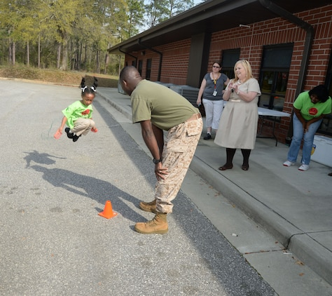 A Child Development Center student, at Marine Corps Logistics Base Albany, jumps rope in a physical fitness team challenge here, March 18. The competition, which is an annual observance of the Campaign for Smoke-free Kids' National Kick Butts Day, was held to deter participating youth from using tobacco products and to promote a healthier lifestyle through physical activity.