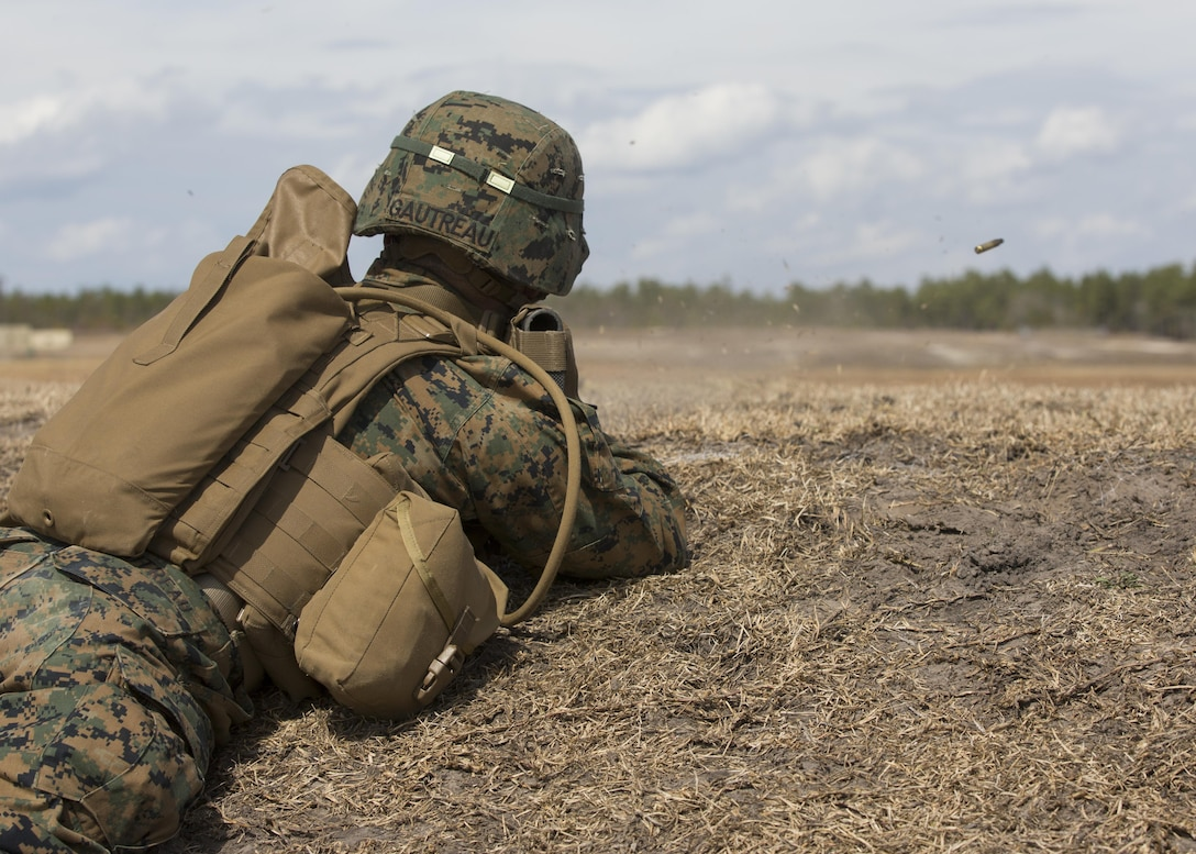 PFC Cade M. Gautreau, a rifleman with Alpha Company, 1st Battalion, 2nd Marine Regiment, sends shots down range during a field exercise aboard Camp Lejeune, N.C., March 4, 2015. Fire teams conducted a live-fire and maneuver ranges to build team cohesion and confidence. (U.S. Marine Corps photo by Lance Cpl. Olivia McDonald/Released)