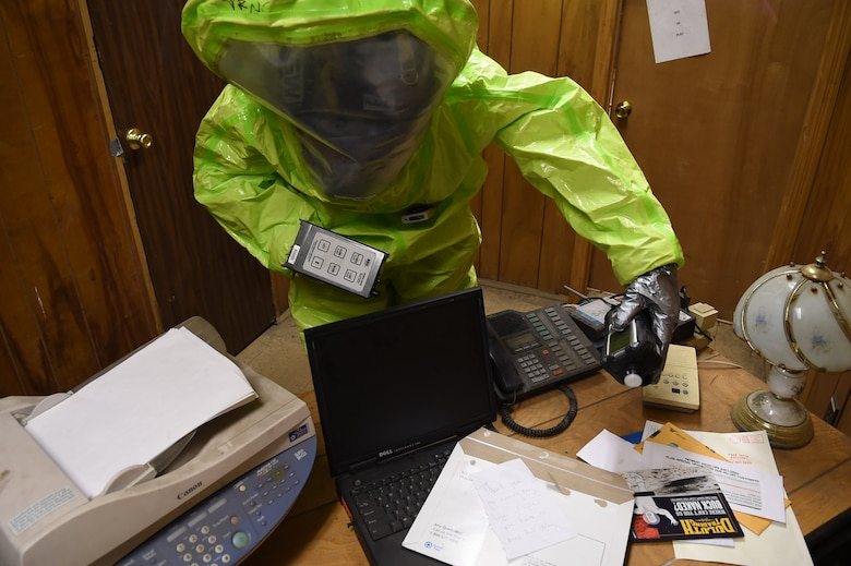Senior Airman Tony Pauline scans an office desk for a potential chemical agent during a training exercise March 17, 2015, in the Memorial Tunnel at the Center for National Response in Gallagher, W.Va. This training is part of the annual Black Flag exercise for first responders. Pauline is a bioenvironmental engineering technician with the 779th Aerospace Medical Squadron at Joint Base Andrews, Md. (U.S. Air Force photo/Senior Airman Joshua R. M. Dewberry)