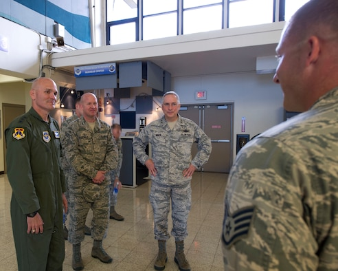 Staff Sgt. Joseph Rucker, passenger services supervisor for the 735th Air Mobility Squadron, briefs Lt. Gen. Carlton D. Everhart II, 18th Air Force commander, Chief Master Sgt. Robert Rodewald , 18th Air Force Command Chief and  Maj. Gen. Frederick Martin, Commander, U.S. Air Force Expeditionary Center, in the Air Mobility Command passenger terminal on Joint Base Pearl Harbor-Hickam, Hawaii, March 22, 2015. Rucker explained the three phases of the planned renovations to the passenger terminal and how the renovations will improve efficiency and comfort for passengers.  The renovations are scheduled to begin on Jan. 16, 2016. (U.S. Air Force photo by Tech. Sgt. Aaron Oelrich/Released)