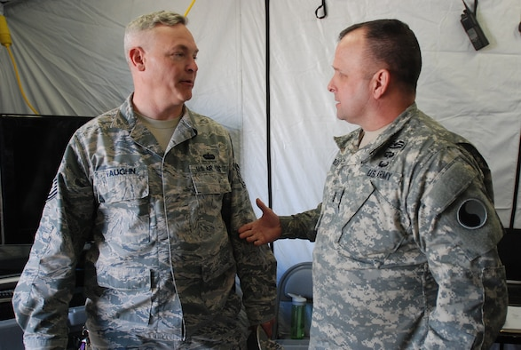 Tech Sgt. Kevin Vaughn (left), an interoperability coordinator with the South Carolina Air National Guard's 169th Communications Flight and Chief Warrant Officer 4 Ed Marquis (right), a tactical communications officer with the Virginia Army National Guard's 29th Infantry Division, discuss interagency communication at a Vigilant Guard exercise March 8, 2015 in Georgetown, S.C. Vigilant Guard is a series of federally funded disaster-response drills conducted by National Guard units working with federal, state and local emergency management agencies and first responders. (U.S. Army National Guard photo by Master Sgt. A.J. Coyne/Released)