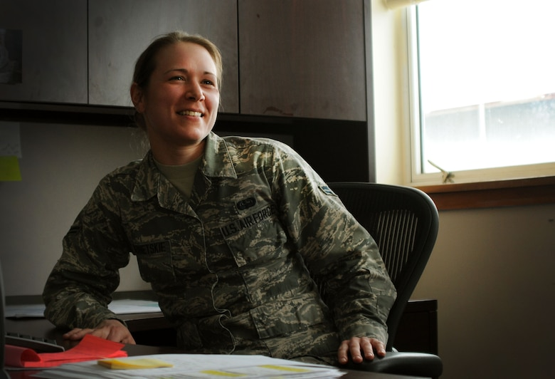 Senior Airman Stacey Bernetskie, 111th Communications Flight client systems technician, smiles while talking with co-workers during the unit training assembly on March 8, 2015, Horsham Air Guard Station, Pennsylvania. Bernetskie is working toward her childhood dream of becoming an Air Force pilot. (U.S. Air National Guard photo by Tech. Sgt. Andria Allmond/Released)