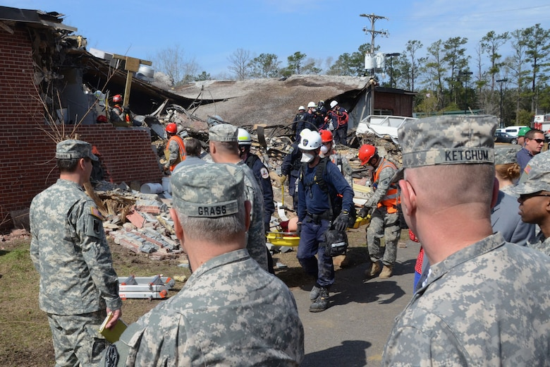 U.S. Army Gen. Frank J. Grass, Chief of the National Guard Bureau and a member of the Joint Chiefs of Staff, and distinguished visitors observe a simulated rescue and recovery operation, at Choppee Recreation Complex in Georgetown, S.C., during Vigilant Guard South Carolina, March 9, 2015. Vigilant Guard is a series of federally funded disaster-response drills conducted by National Guard units working with federal, state and local emergency management agencies and first responders. (U.S. Air National Guard photo by Airman 1st Class Ashleigh S. Pavelek/Released)