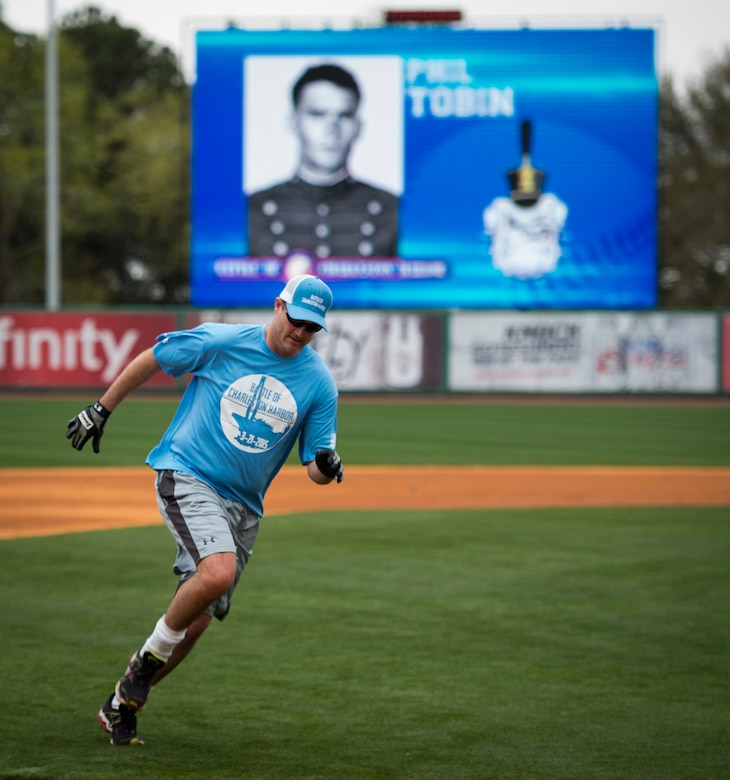 """A member of the Citadel 1990 College World Series baseball team runs the bases during the """"Battle of Charleston Harbor"""" softball tournament March 21, 2015, at Joe Riley Stadium in Charleston, S.C. The """"Battle of Charleston Harbor"""" was a softball game between the Wounded Warrior Amputee Softball Team and the Citadel 1990 College World Series baseball team. (U.S. Air Force photo/Airman 1st Class Clayton Cupit)"""