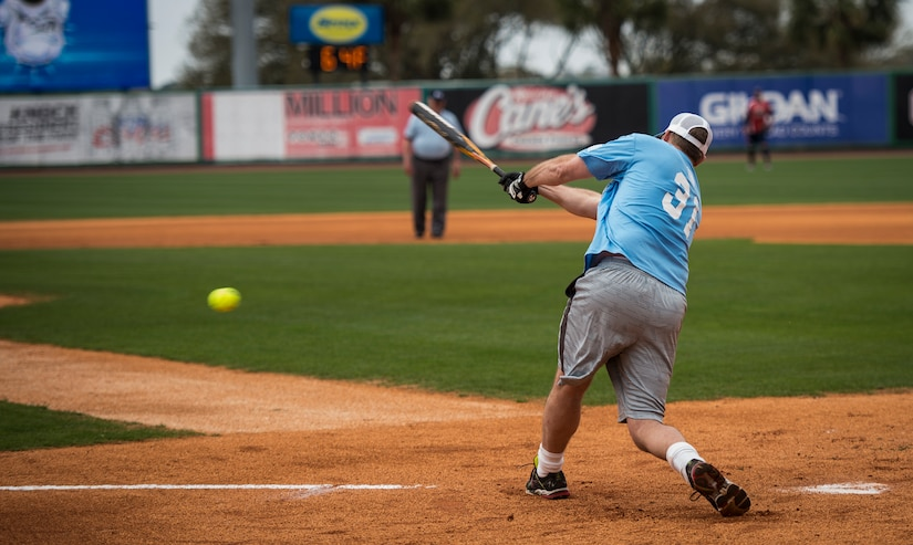 """Scott Elvington, Citadel Alumni, hits a groundball during the """"Battle of Charleston Harbor"""" softball tournament March 21, 2015, at Joe Riley Stadium in Charleston, S.C. The """"Battle of Charleston Harbor"""" was a softball game between the Wounded Warrior Amputee Softball Team and the Citadel 1990 College World Series baseball team. (U.S. Air Force photo/Airman 1st Class Clayton Cupit)"""