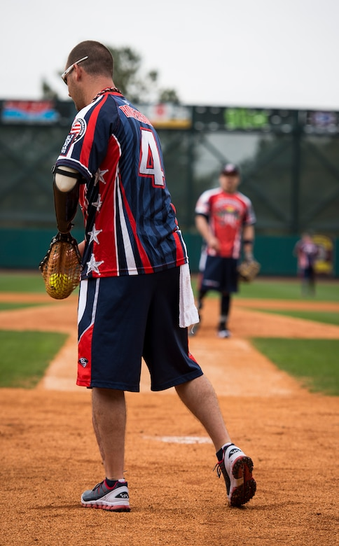 """Leonard Anderson, Wounded Warrior Amputee Softball Team member, catches a softball during the """"Battle of Charleston Harbor"""" softball tournament March 21, 2015, at Joe Riley Stadium in Charleston, S.C. The mission of the WWAST is to raise awareness, through exhibition and celebrity softball games, of the sacrifices and resilience of our military and highlight their ability to rise above any challenge. Their goal is to show other amputees and the general public, that these athletes, through extensive rehabilitation and training, are able to express their desires and perform the sport they love. (U.S. Air Force photo/Airman 1st Class Clayton Cupit)"""