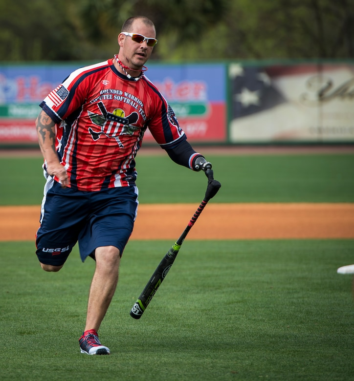 """Leonard Anderson, Wounded Warrior Amputee Softball Team member, hits an inside-the-park home run during the """"Battle of Charleston Harbor"""" softball tournament March 21, 2015, at Joe Riley Stadium in Charleston, S.C. The mission of the WWAST is to raise awareness, through exhibition and celebrity softball games, of the sacrifices and resilience of our military and highlight their ability to rise above any challenge. Their goal is to show other amputees and the general public, that these athletes, through extensive rehabilitation and training, are able to express their desires and perform the sport they love. (U.S. Air Force photo/Airman 1st Class Clayton Cupit)"""