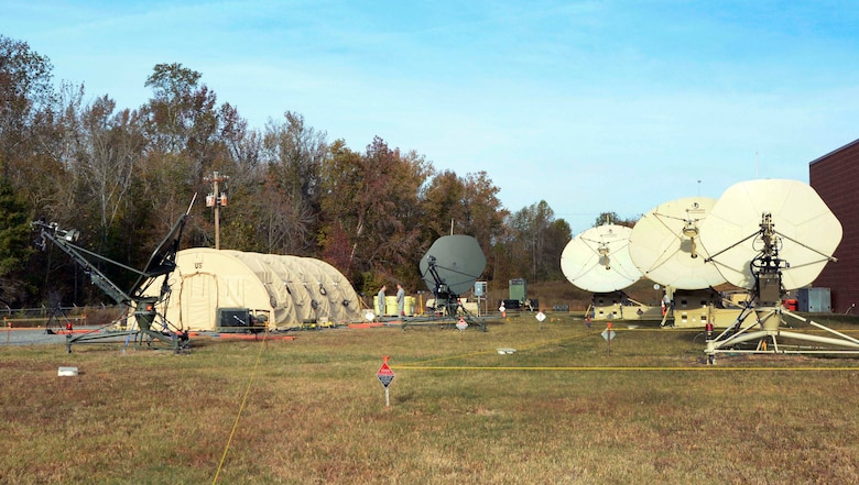 Members from the 263rd Combat Communication Squadron hosted more than 50 active duty, reserve and National Guard airmen during joint training exercises held March 2015 at the North Carolina Air National Guard base, Combat Operations Group, New London, N.C. During these total force exercises satellite antennas are used in various capacities to perform Electromagnetic Interference dogfights. Communication is the life-blood of any natural disaster, crisis or conflict. By working closely with satellite controllers, 263rd personnel were able to recognize the jamming and restore the communications mission assigned to them. Nearly 37,000 Sailors, Marines and Airmen were supported during three U.S. Strategic Command and U.S. Navy exercises. (U.S. Air National Guard photo by Master Sgt. Patricia F. Moran, 145th Public Affairs/Released)