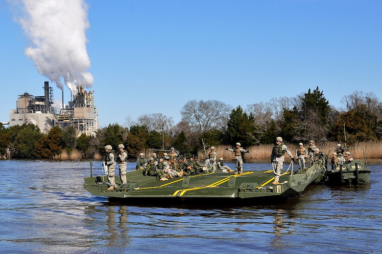 U.S. Army Engineers with the South Carolina Army National Guard's 125th Multi-Role Bridge Company (MRBC) conduct simulated ferry operations March 7, 2015 during Vigilant Guard 15. This exercise is designed to simulate a joint emergency response following the impact of a category four hurricane.  Hundreds of Georgia National Guardsmen are participating in Vigilant Guard 15 along with more than 2,000 Guardsmen from North and South Carolina during 3 to12 March. Vigilant Guard is a series of federally-funded disaster-response drills conducted by National Guard units working with federal, state and local emergency management agencies and first responders. (U.S. Army National Guard photo by Capt. William Carraway/Released)