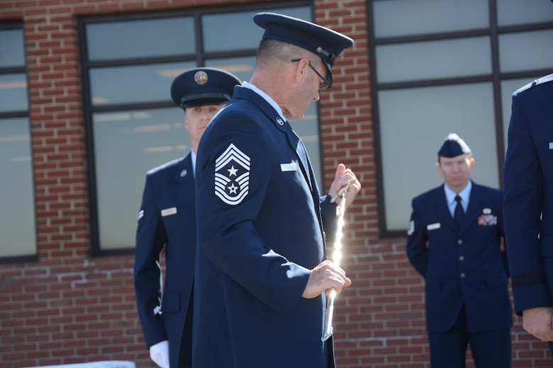 U.S. Air Force State Command Chief Master Sgt. Michael D. Stanley, accepted the position of the highest enlisted airman in the North Carolina Air National Guard, as he inspects the non-commissioned officer's sword during a Change of Authority ceremony held at the North Carolina Air National Guard base, Charlotte Douglas Int'l. Airport, Feb. 8, 2015. (U.S. Air National Guard photo by Master Sgt. Rich Kerner, 145th Public Affairs/Released)