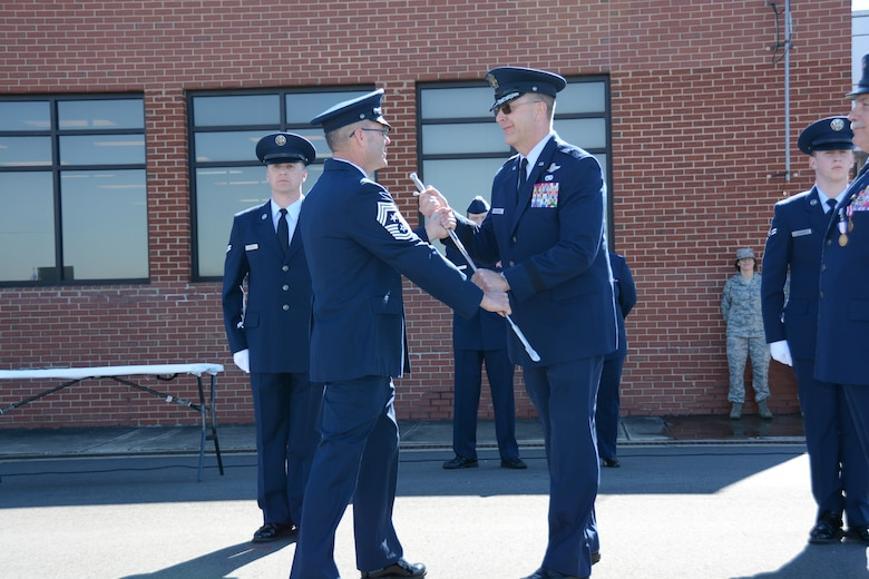 U.S. Air Force State Command Chief Master Sgt. Michael D. Stanley, North Carolina Air National Guard receives the non-commissioned officer's sword from Brig. Gen. Roger E. Williams Jr., Assistant Adjutant General for Air, during a Change of Authority ceremony held at the North Carolina Air National Guard base, Charlotte Douglas Int'l. Airport, Feb. 8, 2015. The passing of the sword signifies honor and gratitude for the opportunity to care for the North Carolina Air National Guard's airmen. (U.S. Air National Guard photo by Master Sgt. Rich Kerner, 145th Public Affairs/Released)