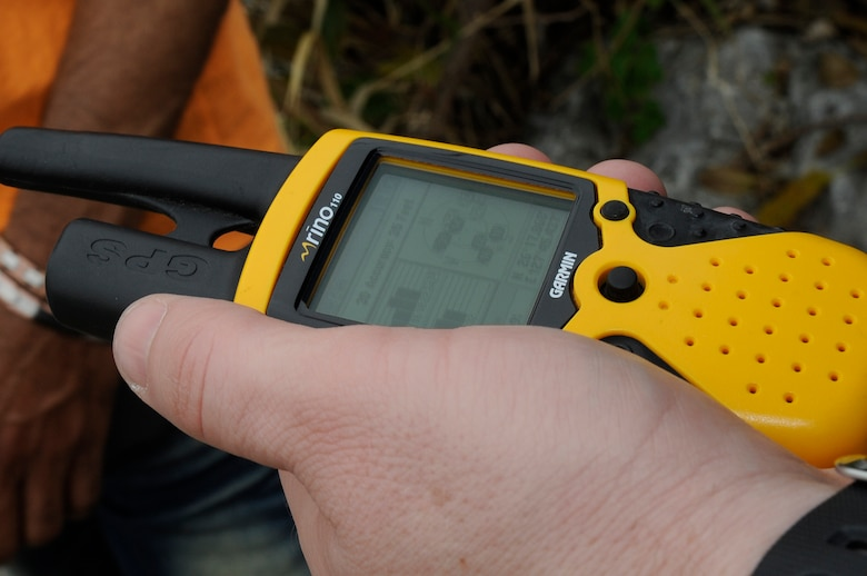A Catholic youth group member from Kadena Air Base, Japan, checks the coordinates on their hand-held GPS to find a geocache near Araha Beach, March 21, 2015. Geocaching became popular around the year 2000 when GPS became more accurate and accessible to the public. (U.S. Air Force photo by Staff Sgt. Marcus Morris)