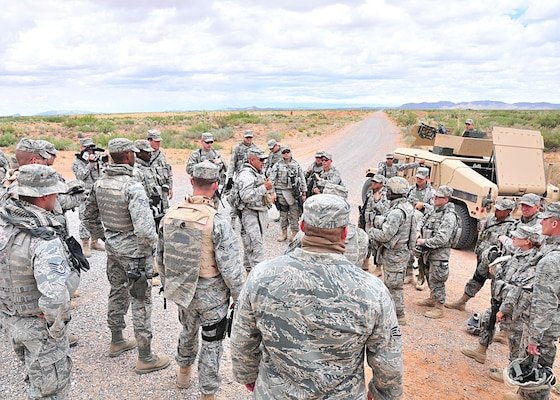 Active duty Air Force security forces Airmen are debriefed after a convoy live fire exercise by an instructor from the Texas Air Guard's Desert Defender Regional Training Center area security operations course at the McGregor Range outside El Paso, Texas, June 30, 2010.