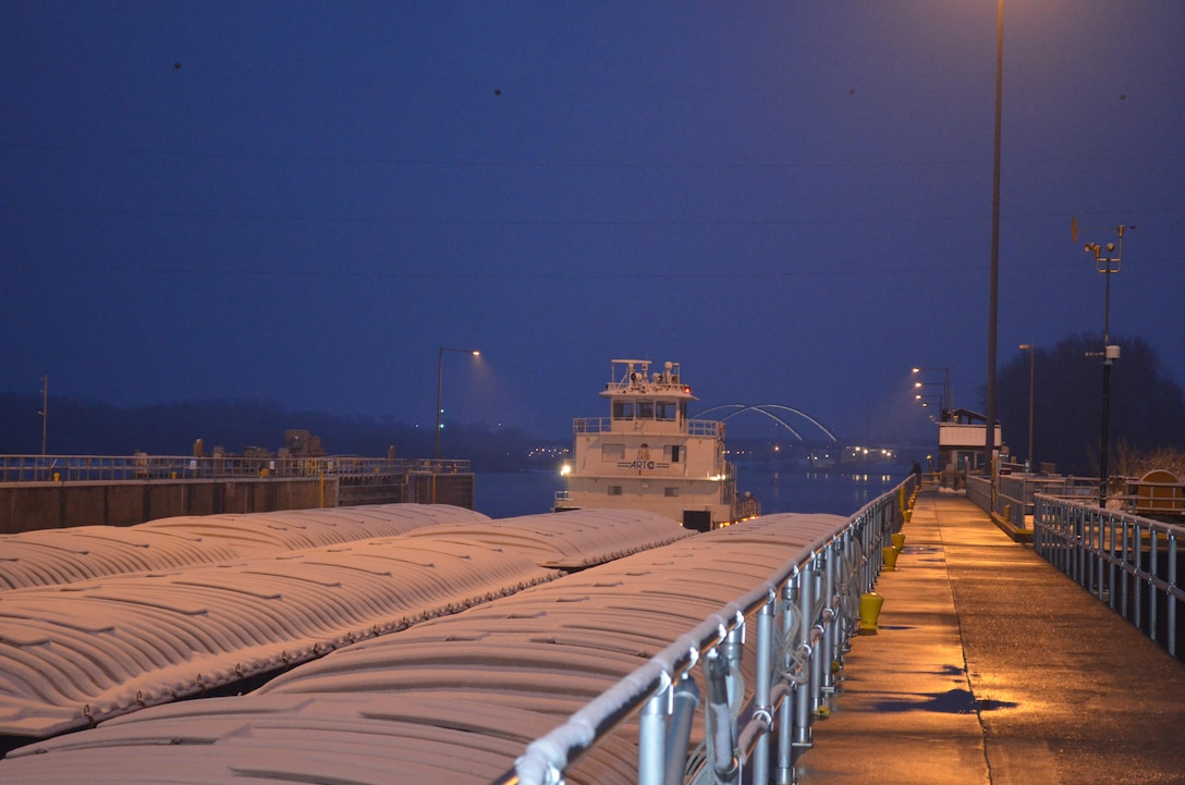 M/V New Dawn broke through Lake Pepin ice overnight and locked through Lock and Dam 2, near Hastings, Minnesota, around 7:45 on March 25, 2015, marking the unofficial start to the navigation season for the Upper Mississippi River. The American River Transportation Company boat was pushing nine barges loaded with fertilizer.