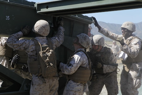 Marines from Bridge Company, 7th Engineer Support Battalion, 1st Marine Logistics Group, conduct a bridge exercise at Lake Elsinore, Calif., March 24. Marines built an Improved Ribbon Bridge and a Medium Girder Bridge.