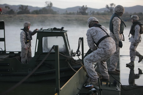 Marines from Bridge Company, 7th Engineer Support Battalion, 1st Marine Logistics Group, conduct a bridge exercise at Lake Elsinore, Calif., March 24. Marines built an Improved Ribbon Bridge and a Medium Girder Bridge.
