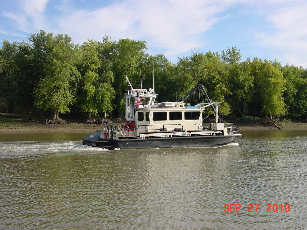 Survey Vessel Holling accompanied by the Jessica Joy on the Mississippi River.