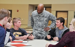 WINCHESTER, Va. - Col. Vincent V. Quarles, commander of U.S. Army Corps of Engineers, Middle East District, greets students from area high schools and shares his enthusiasm for engineering at the annual Day with an Engineer March 19 at Lord Fairfax Community College's Middletown campus.
