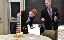 WINCHESTER - Judges measure the height of water to determine the winner of the tower construction project by local high school students in the design/build activity portion during the U.S. Army Corps of Engineers, Middle East District's annual Day With an Engineer March 19 at Lord Fairfax Community College's Middletown campus.