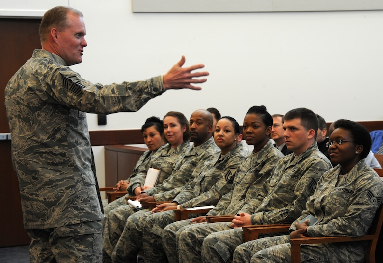 Chief Master Sgt. of the Air Force James A. Cody addresses Airmen March 23, 2015, during his visit to Joint Base Andrews, Md. Cody serves as the personal adviser to the chief of staff of the Air Force and the secretary of the Air Force on all issues regarding the welfare, readiness, morale, and proper utilization and progress of the enlisted force. (U.S. Air Force photo/Master Sgt. Tammie Moore)