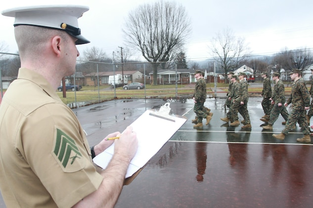U.S. Marine Corps Sgt. Michael L. Benson, a recruiter from Recruiting Sub-station Huntington and native of Chillicothe, Ohio, inspects Marine Corps Junior Reserve Officer's Training Corps cadets at St. Albans High School March 10, 2015, in St. Albans, West Virginia. Marines inspect cadets in the program every two years, judging the students on their confidence, attention to detail, leadership traits and more.  (U.S. Marine Corps photo by Sgt. Caitlin Brink/Released)