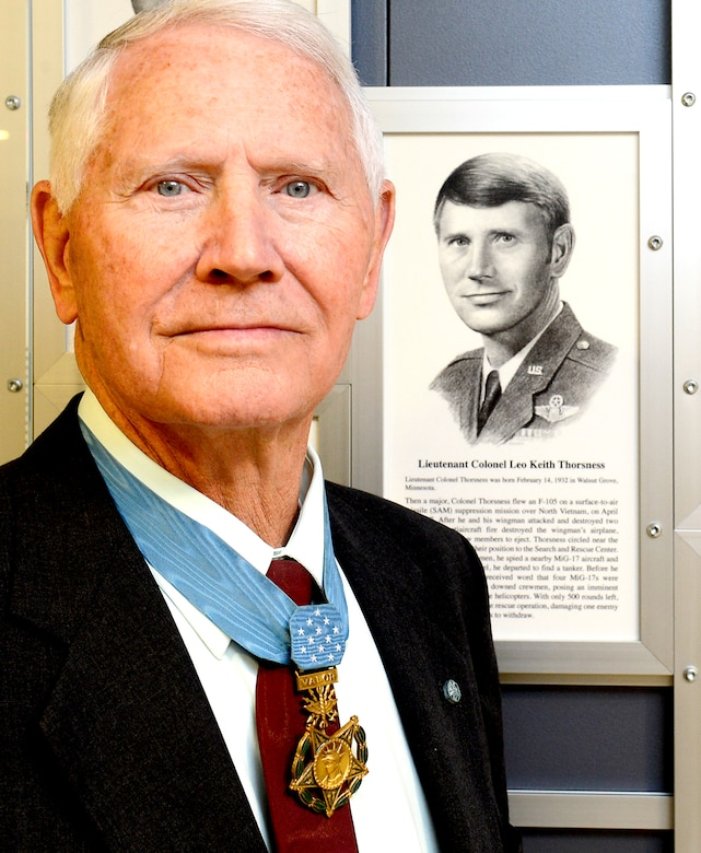 Retired Col. Leo Thorsness poses with a permanent Medal of Honor display March 24, 2015, at the Pentagon in Washington D.C. The display depicts him and other medal recipients.  Thorsness was in the Pentagon with fellow Medal of Honor recipient, Joe Jackson for a Q-and-A session with members of the Air Staff, hosted in the Hall of Heroes.  Jackson and Thorsness also met with Secretary of the Air Force Deborah Lee James and Air Force Vice Chief of Staff Gen. Larry Spencer.  (U.S. Air Force photo/Scott M. Ash)
