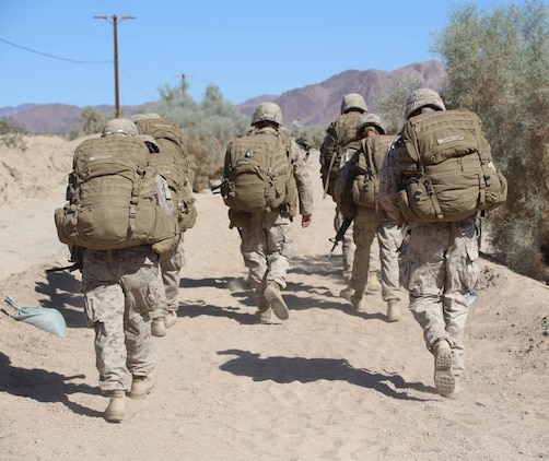 Marines with Engineer Platoon, Headquarters and Service Company, Ground Combat Element Integrated Task Force, conduct a four and a half mile hike to Range 110, Marine Corps Air Ground Combat Center Twentynine Palms, California, March 23, 2015. From October 2014 to July 2015, the GCEITF will conduct individual and collective level skills training in designated ground combat arms occupational specialties in order to facilitate the standards-based assessment of the physical performance of Marines in a simulated operating environment performing specific ground combat arms tasks. (U.S. Marine Corps photo by Cpl. Paul S. Martinez/Released)