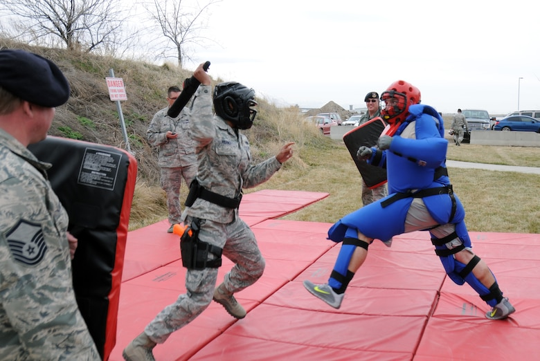 Master Sgt. Shatiece Werner, 151st Security Forces Squadron, uses a baton to 