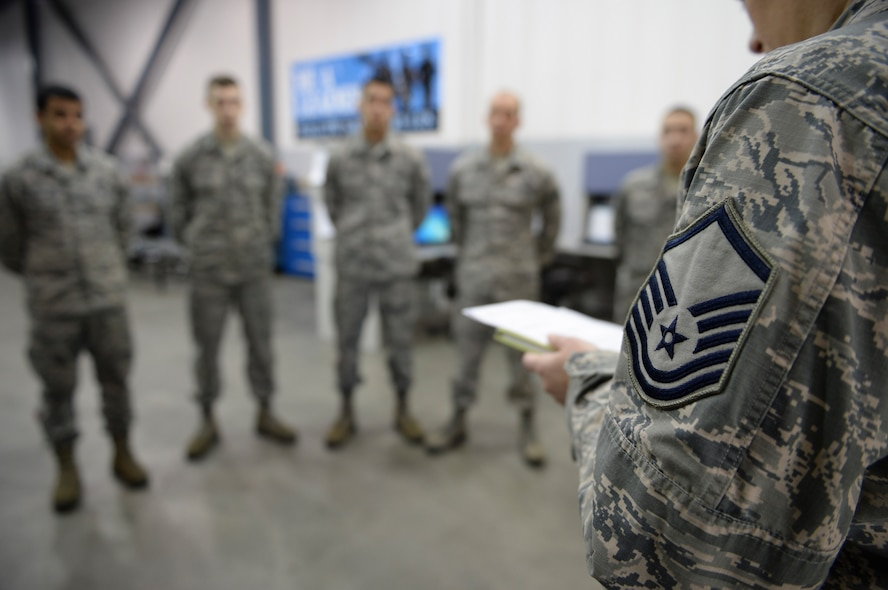 U.S. Air Force Master Sgt. Keri Frandson, the 354th Aircraft Maintenance Squadron armament flight chief, leads a morning all call at the Armament Back shop March 18, 2015, Eielson Air Force Base, Alaska. Frandsen took accountability for each shop section and updated Airmen with news and reports. (U.S. Air Force photo by Senior Airman Peter Reft/Released)