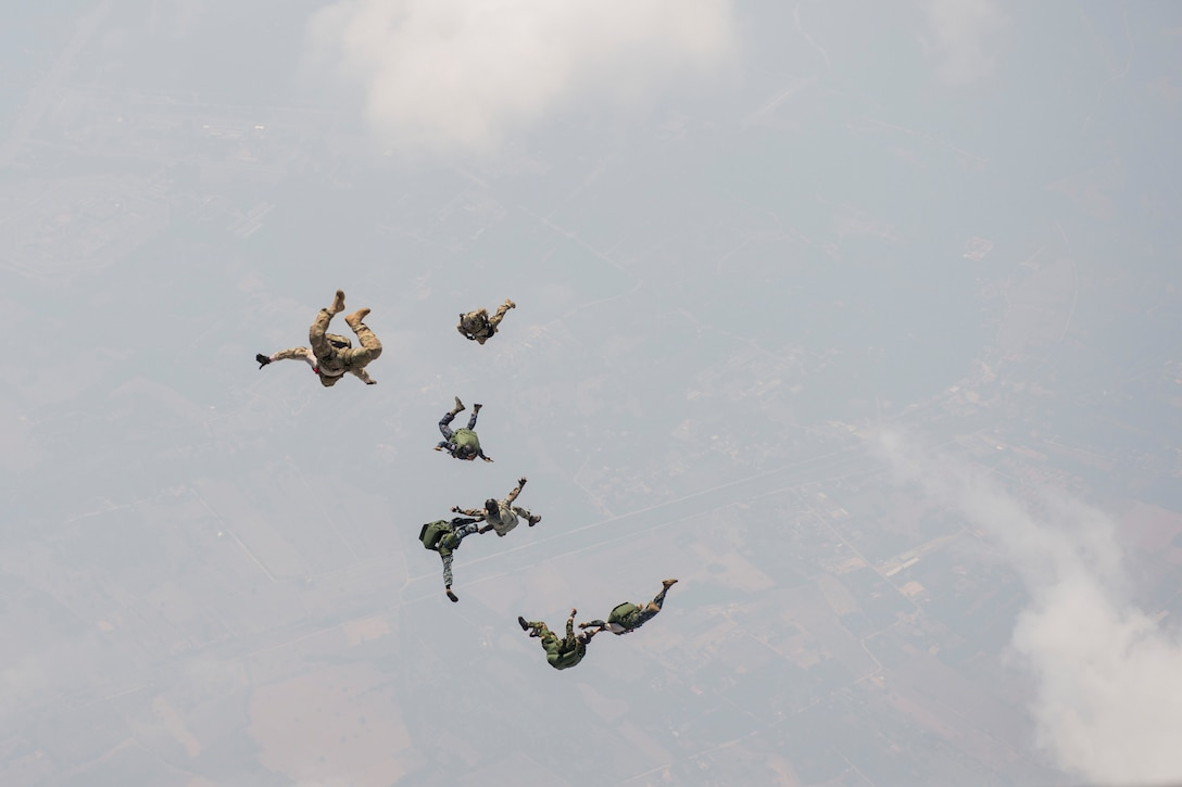 U.S. and Thai air forces conduct a High Altitude Low Opening jump from a U.S. C-130 during Exercise Cope Tiger 15 near Udon, Thailand, March 11, 2015. CT15 includes 22 total flying units and over 1,390 personnel from three countries and continues the growth of strong, interoperable and beneficial relationships within the Asia-Pacific region through integration of airborne and land-based command and control assets. (U.S. Air Force photo by Airman 1st Class Taylor Queen/Released)