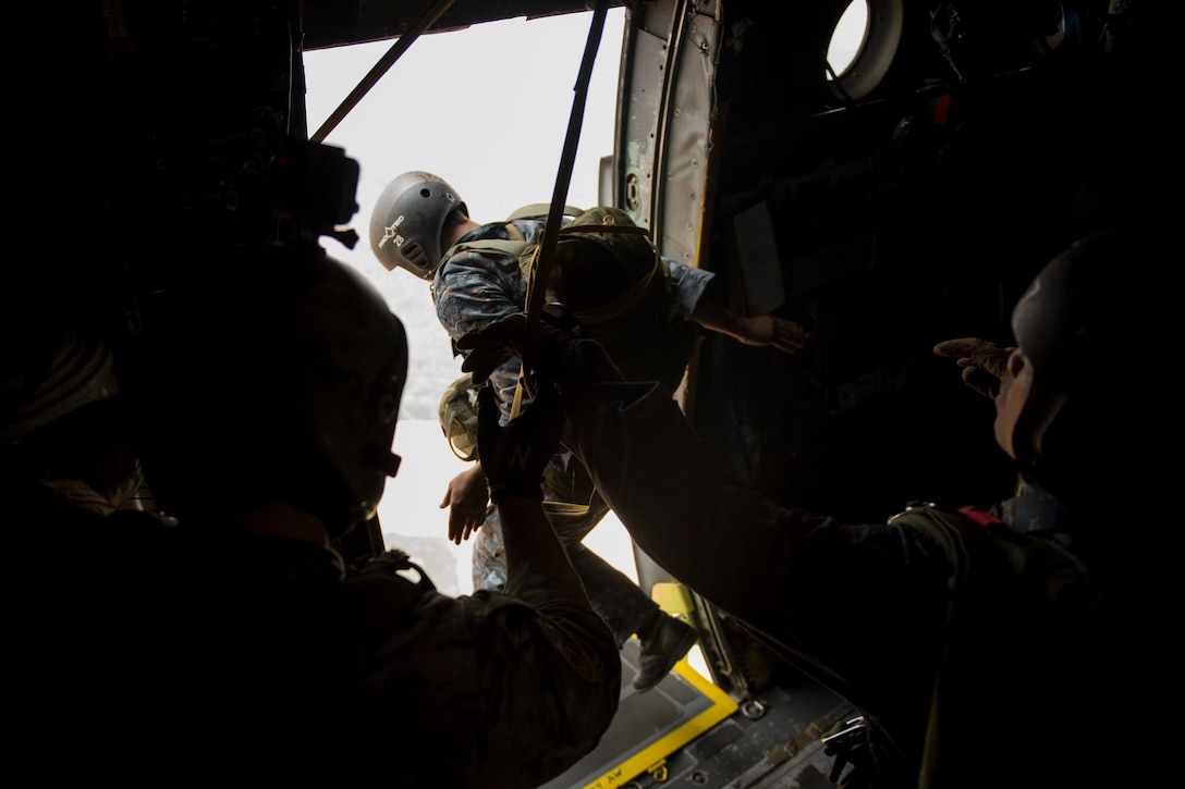 A Royal Thai air force member jumps from a U.S. Air Force C-130 during Exercise Cope Tiger 15 near Udon, Thailand, March 11, 2015. CT15 includes 22 total flying units and over 1,390 personnel from three countries and continues the growth of strong, interoperable and beneficial relationships within the Asia-Pacific region through integration of airborne and land-based command and control assets. (U.S. Air Force photo by Airman 1st Class Taylor Queen/Released)