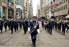 U.S. Air Force Senior Master Sgt. John E. Christ, drum major with the 553rd Air Force Band, leads the Air National Guard Band of the Northeast during a performance in the New York City St. Patrick's Day Parade in New York March 17, 2015. The band played for spectators along the parade's Fifth Avenue route as part of its community relations mission. (U.S. Air National Guard photo by Staff Sgt. Lealan Buehrer/Released)