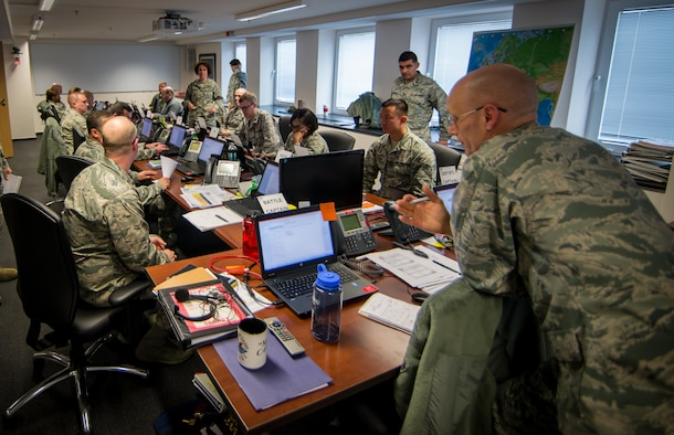 The U.S. Air Forces in Europe and Air Forces Africa battle staff monitors events during a large-scale defense exercise that consists of computer-based command post simulations to test Airmen assigned to the headquarters on Ramstein Air Base, Germany, March 22, 2015. The scenarios selected for Exercise Austere Challenge & Judicious Response 2015 are designed to train our forces to face any situation. (U.S. Air Force photo/ Staff Sgt. Ryan Crane/Sensitive information blurred using photo editing software)