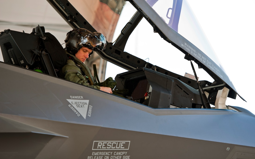 Royal Australian Air Force Squadron Leader Andrew Jackson, F-35 Lightning II student pilot, prepares for his first flight in an F-35A on Eglin Air Force Base, Fla., March 18, 2015. After Jackson completes his training at Eglin AFB, he will go to Luke Air Force Base, Ariz., to be in instructor pilot at the international pilot center. (U.S. Air Force photo/Staff Sgt. Marleah Robertson)