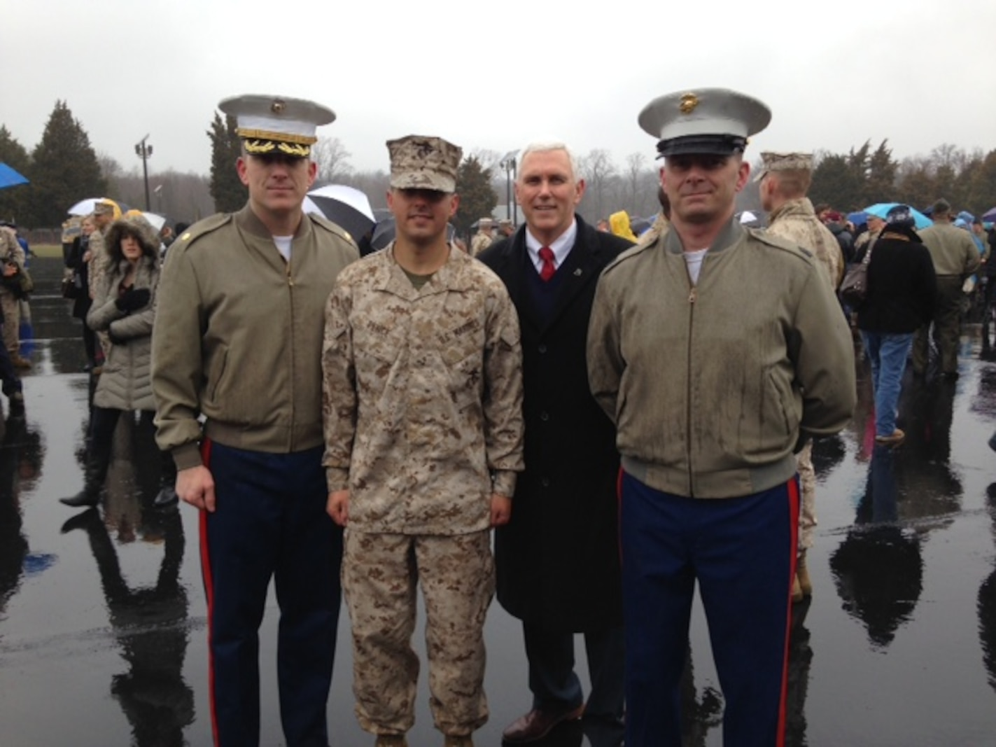 Indiana Gov. Mike Pence, second from right, joins his son, Marine 2nd Lt. Michael J. Pence, second from left, along with Maj. Geoffry M. Hollopeter, left, Recruiting Station Indianapolis commanding officer, and Sgt. Maj. Ronald E. Neff, right, RS Indianapolis sergeant major, during Michael Pence's Officer Candidate School graduation aboard Marine Corps Base Quantico, Virginia March 20, 2015. Michael Pence received his commission through OCS after graduating from Purdue University in 2014.