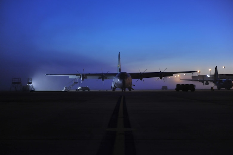 A C-130J sits on the flightline at dawn, awaiting maintenance March 16, 2015, at Little Rock Air Force Base, Ark. Little Rock is the home of C-130 combat airlift, with 22 percent of the total Air Force C-130 inventory residing at the base. (U.S. Air Force photo by Tech. Sgt. Russ Scalf)