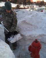 Snow shoveling, such as this shown in Massachusetts last month, was just one way someone in a community helped a National Guard family in a time of need. Community-based family service programs are an important component in a Citizen-Soldier's family.