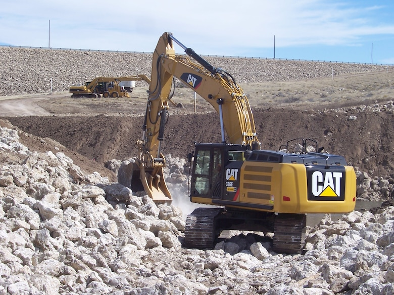 ROSWELL, N.M. – Construction equipment and crew from Reclamation work on a new flood channel at the District's Two River's Diamond A Dam, March 8, 2015.