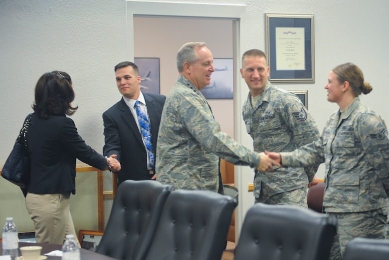 Air Force Chief of Staff Gen. Mark A. Welsh III is saluted by Senior Airman Erin Litchfield, 55th Electronic Combat Group acquisition operator, after presenting her with his coin at Davis-Monthan Air Force Base, Ariz., March 25, 2015. Welsh coined five superstars during a mission brief and thanked Airmen for their service. (U.S. Air Force photo by Cheyenne Morigeau/released)