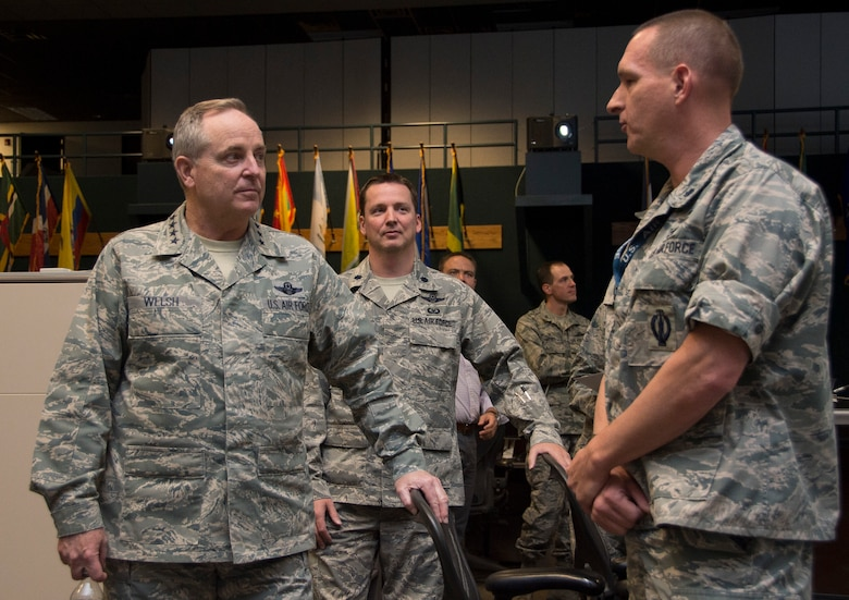 Air Force Chief of Staff Gen. Mark A. Welsh III, receives a brief from Lt. Col John Ferko, Air Forces Southern chief of special tactical operations, during a visit to the 612th Air Operations Center on March 25, 2015 at Davis-Monthan AFB, Ariz. During the visit, Welsh engaged with both leadership and Airmen during a base-wide all call. (U.S. Air Force photo by Staff Sgt. Adam Grant/Released)
