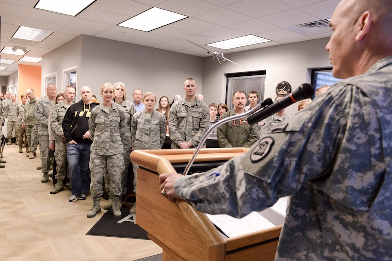 The Adjutant General of the Iowa National Guard, Maj. Gen. Timothy Orr (podium), speaks to members of the Iowa Air and Army National Guard as they celebrate the opening of the 132d Wing, Des Moines, Iowa off-site Recruiting Operation Center during a ribbon cutting ceremony held at the new Recruiting Operation Center in West Des Moines, Iowa on Tuesday, March 24, 2015.  (U.S. Air National Guard photo by Staff Sgt. Linda K. Burger/Released)