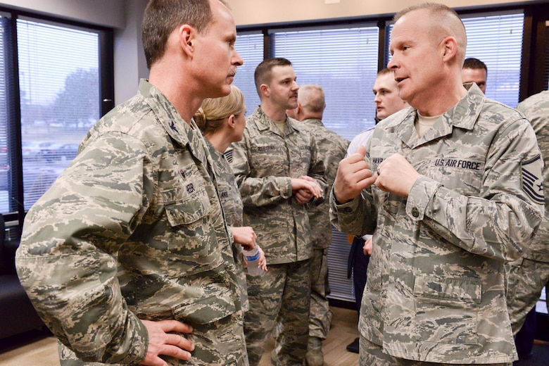 Members of the Iowa Air and Army National Guard celebrate the opening of the 132d Wing, Des Moines, Iowa off-site Recruiting Operation Center during a ribbon cutting ceremony held at the new Recruiting Operation Center in West Des Moines, Iowa on Tuesday, March 24, 2015.  (U.S. Air National Guard photo by Staff Sgt. Linda K. Burger/Released)