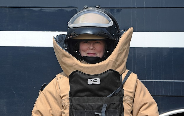 Tech. Sgt. Molly Callen, 8th Civil Engineer Squadron explosive ordnance disposal team lead, dons the Med-Eng EOD-9 bomb suit March 20, 2015 at Kunsan Air Base, Republic of Korea. As an EOD technician, Callen is trained to deactivate improvised explosive devices and to inspect unexploded ordnances. (U.S. Air Force photo by Senior Airman Divine Cox/Released)